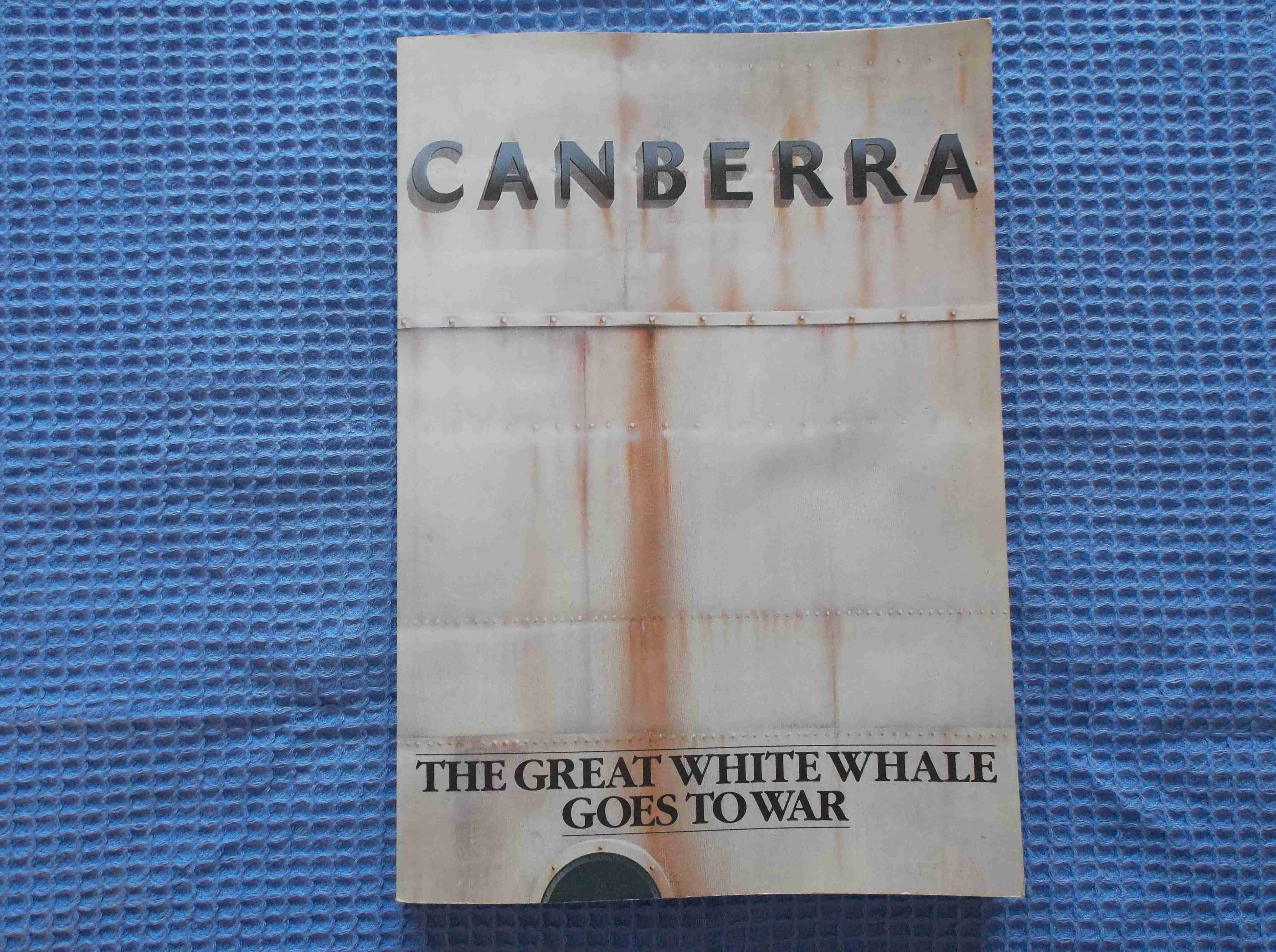 BOOK ENTITLED CANBERRA 'THE GREAT WHITE WHALE GOES TO WAR' by LT CDR JL MUXWORTHY, RN
