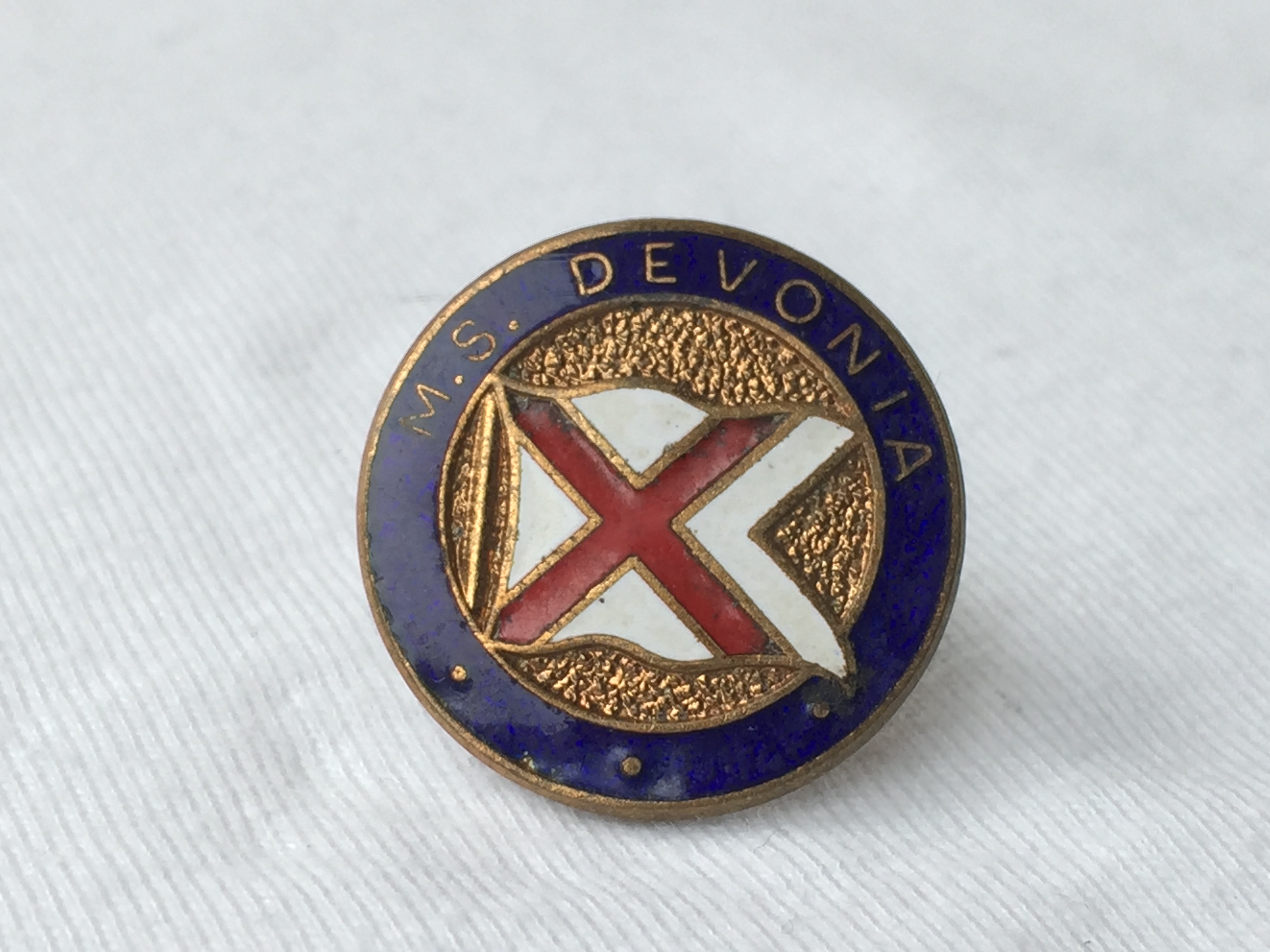 LAPEL PIN BADGE FROM THE BRITISH INDIA STEAM NAVIGATION COMPANY LINE VESSEL THE MS DEVONIA 1938-1967