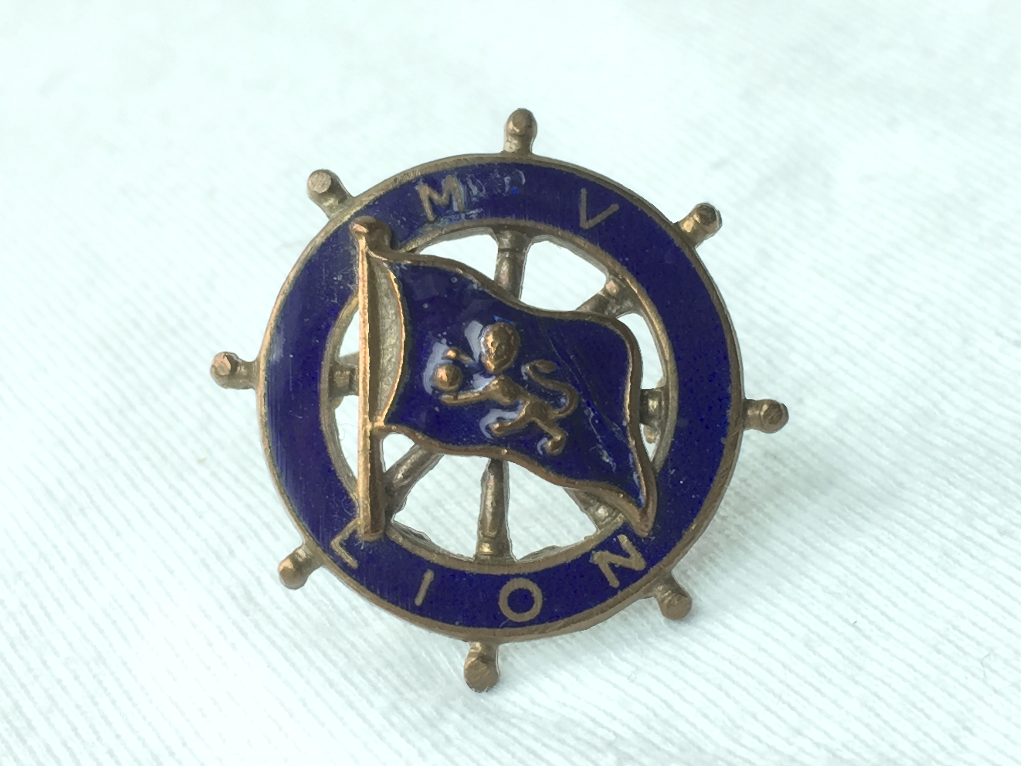 LAPEL PIN BADGE FROM THE BURNS AND LAIRDS LINE VESSEL THE MV LION