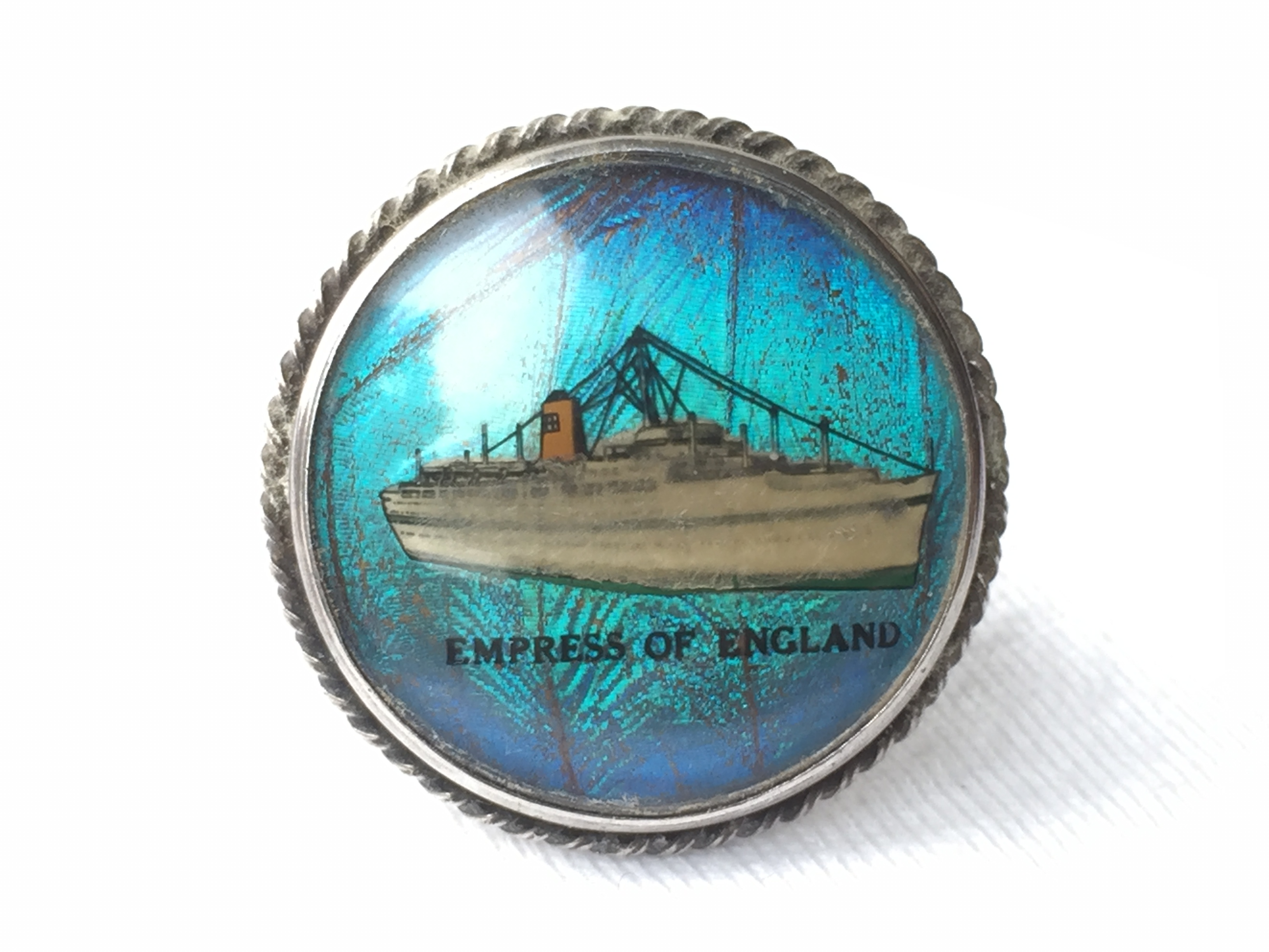 LAPEL PIN BADGE FROM THE CANADIAN PACIFIC LINE VESSEL THE EMPRESS OF ENGLAND 1956-1970