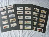 SET OF ORIGINAL 1940's CIGARETTE CARDS SHOWING BOATS, PLANES, TRAINS AND CARS