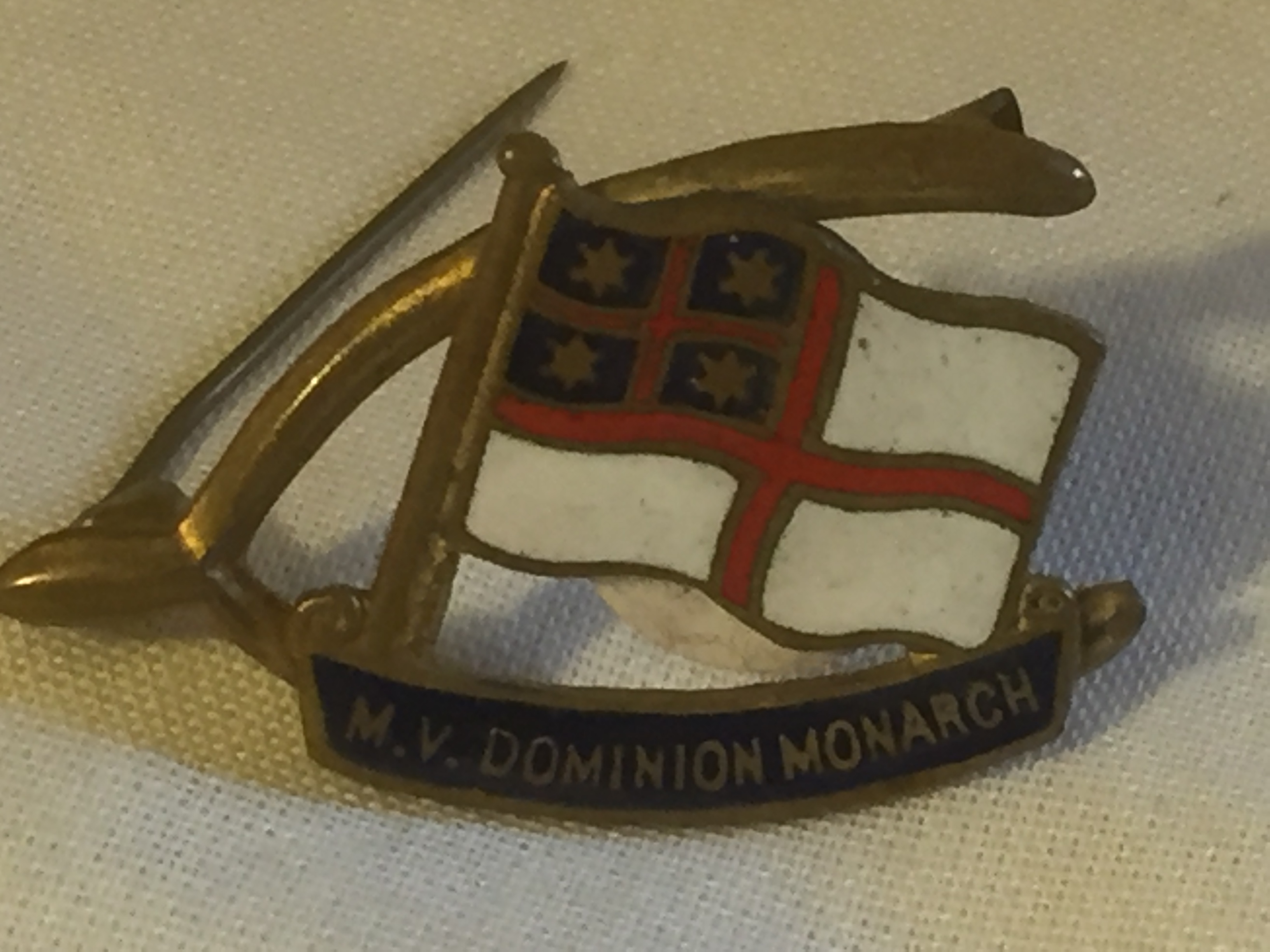 EARLY LAPEL PIN BADGE FROM THE DOMINION MONARCH A UK PASSENGER VESSEL