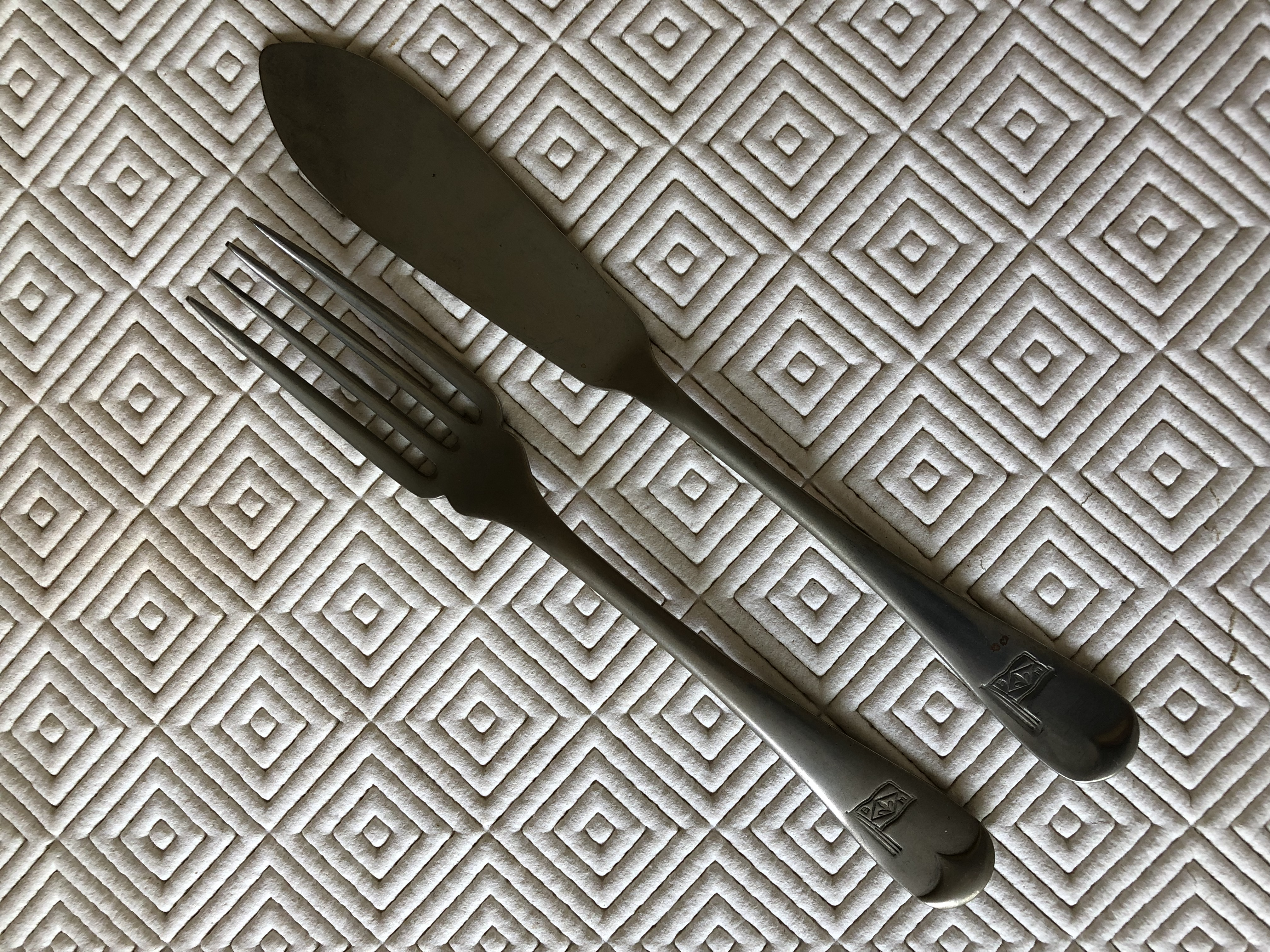 AS USED IN SERVICE SHIPS DINING KNIFE AND FORK FROM THE BURIES MARKS LINE