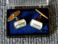 VERY EARLY SOUVENIR ITEM OF A PAIR OF CUFFLINKS FROM THE ORIGINAL VESSEL THE RMS QUEEN ELIZABETH