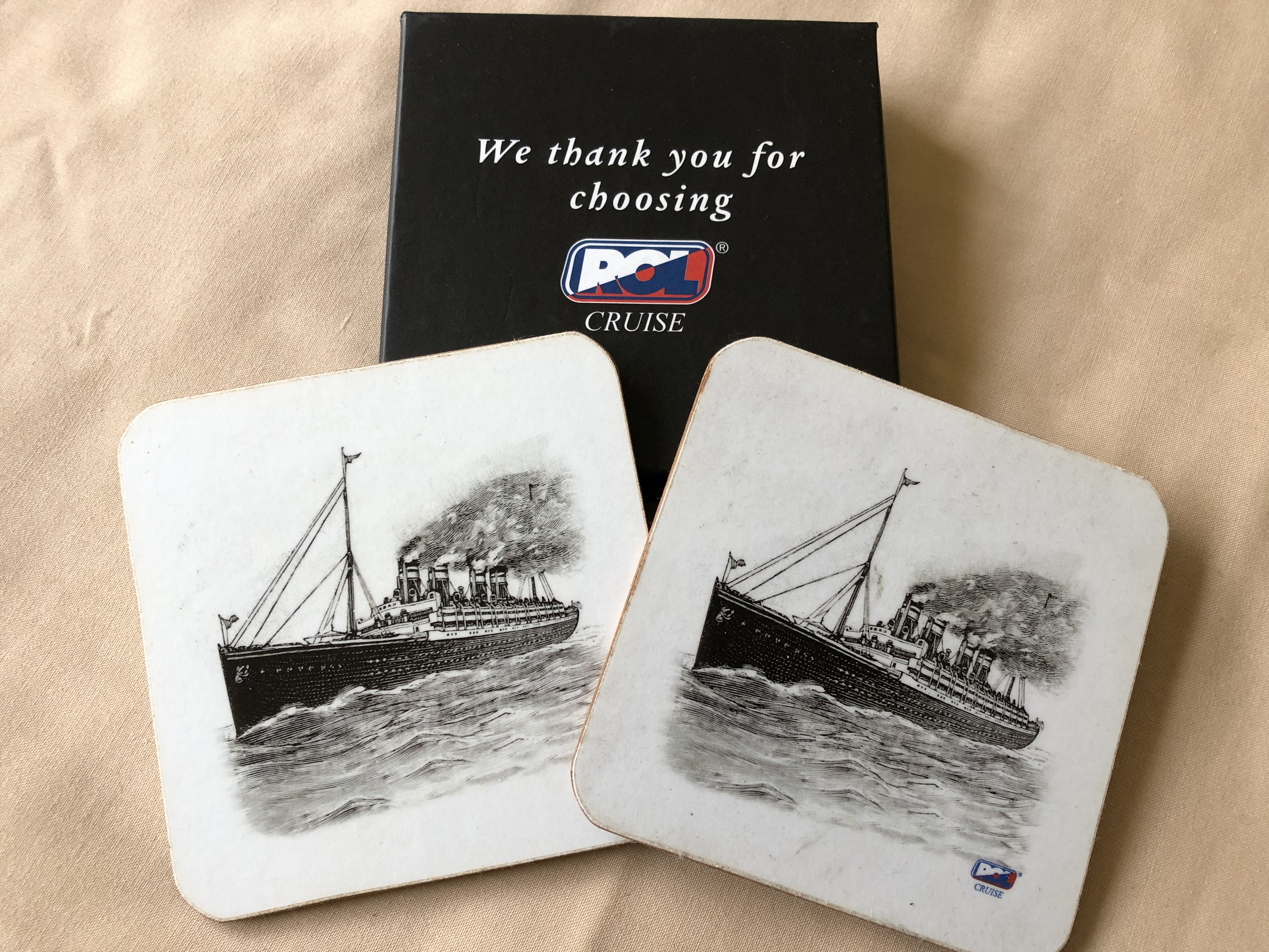 PAIR OF SOUVENIR MATS FROM THE ROL CRUISE BOOKING COMPANY