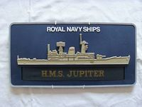WALL PLAQUE AND CAP TALLY FROM THE ROYAL NAVAL VESSEL HMS JUPITER
