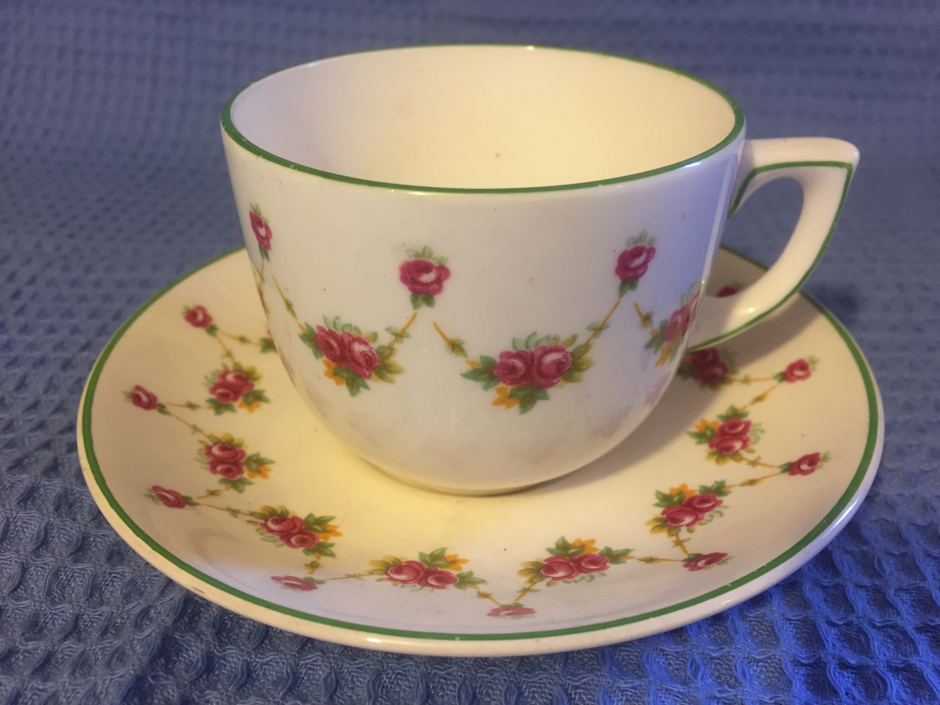 CUP & SAUCER IN DECORATIVE COMPANY PATTERN FROM THE UNION CASTLE LINE