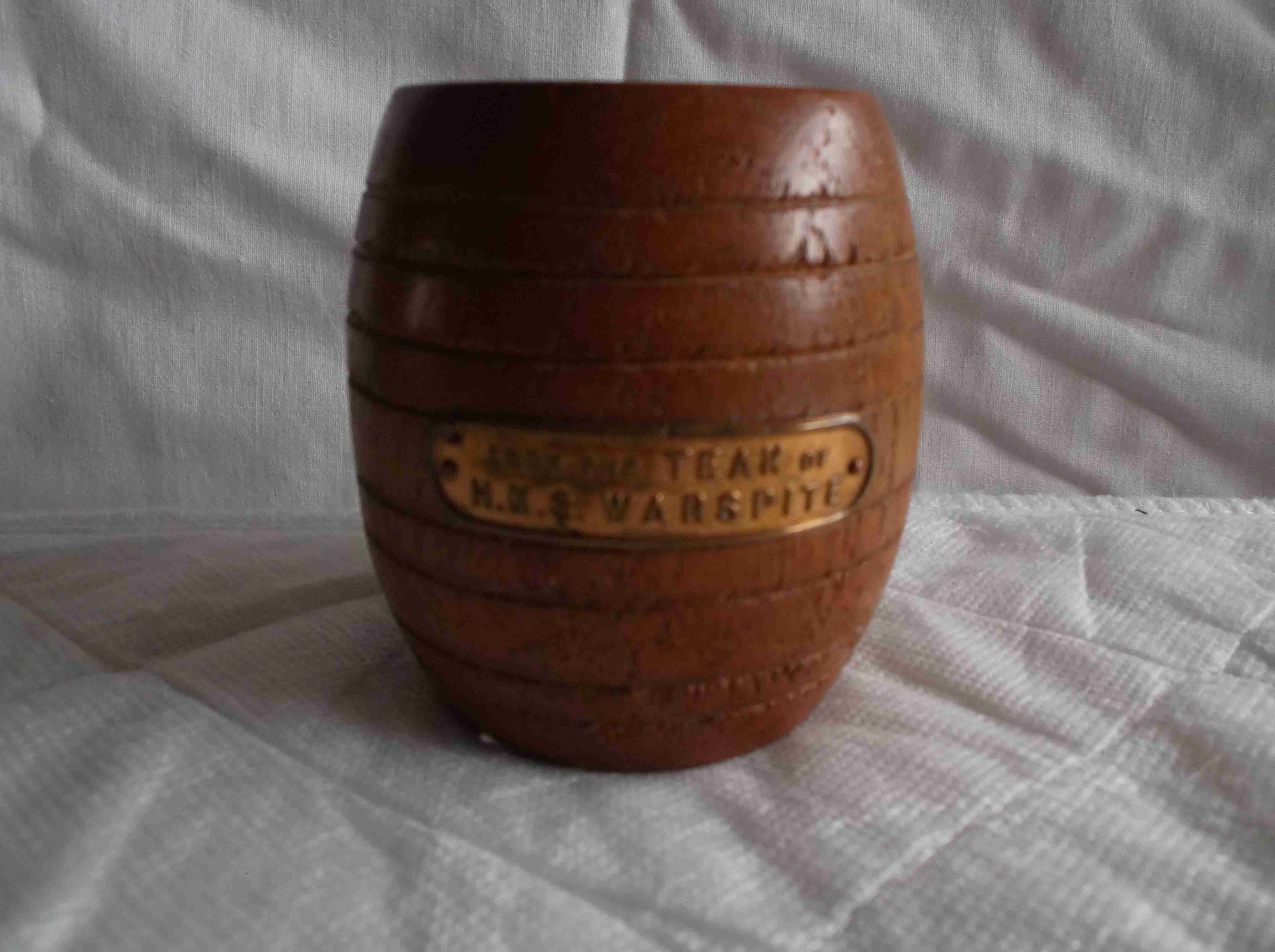 WOODEN BARREL MADE FROM THE REMAINS OF THE ROYAL NAVAL VESSEL HMS WARSPITE