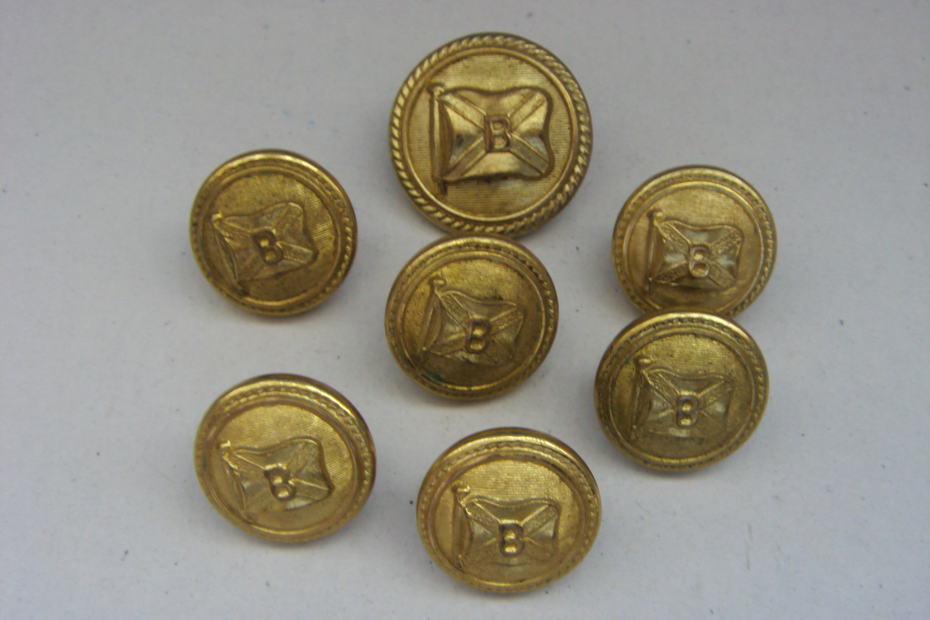 ASSORTED SIZE COLLECTION OF GOLD COLOURED OFFICERS COAT BUTTONS FROM THE BOOTH STEAMSHIP LINE CIRCA 1930's