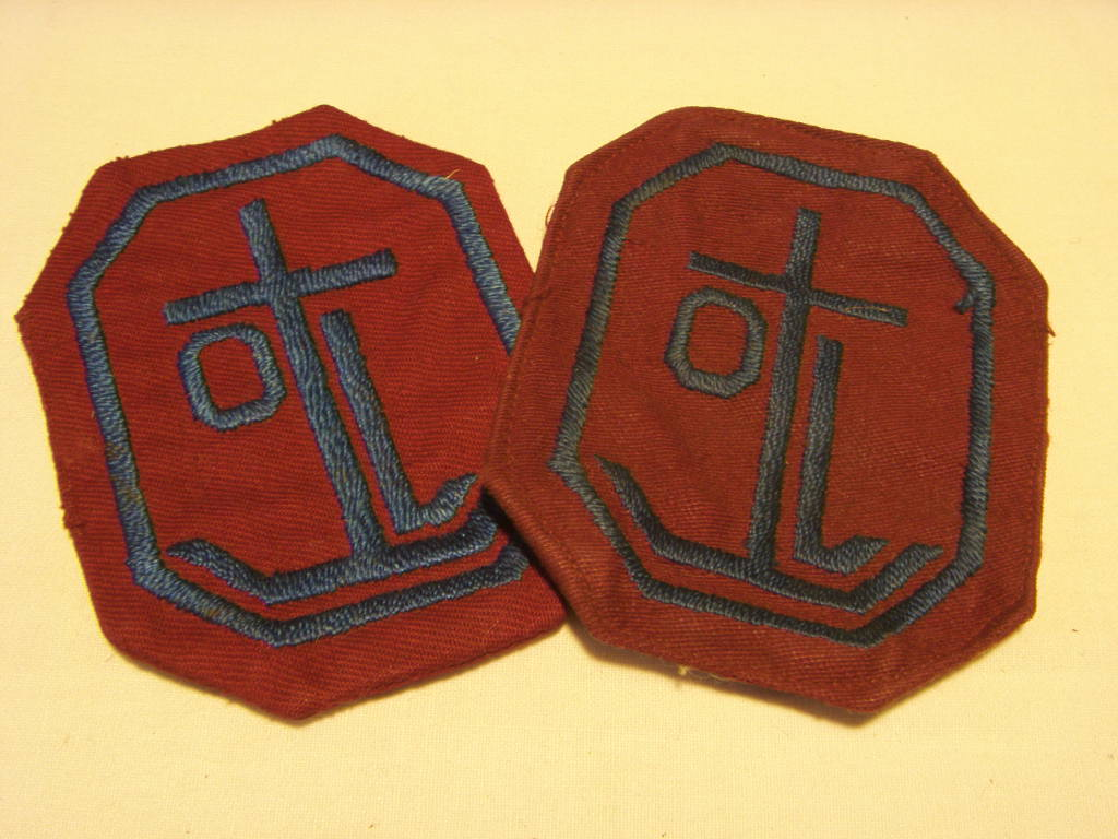 PAIR OF ORIGINAL DESIGN JACKET BADGES FROM THE ORIENT LINE