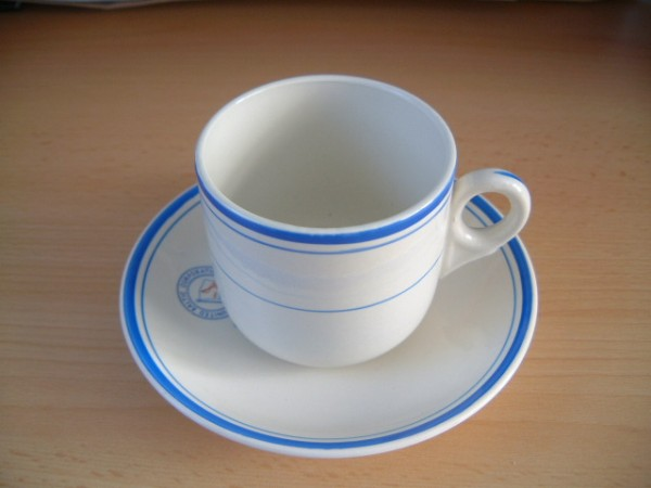 CUP AND SAUCER FROM THE UNITED BALTIC CORPORATION COMPANY