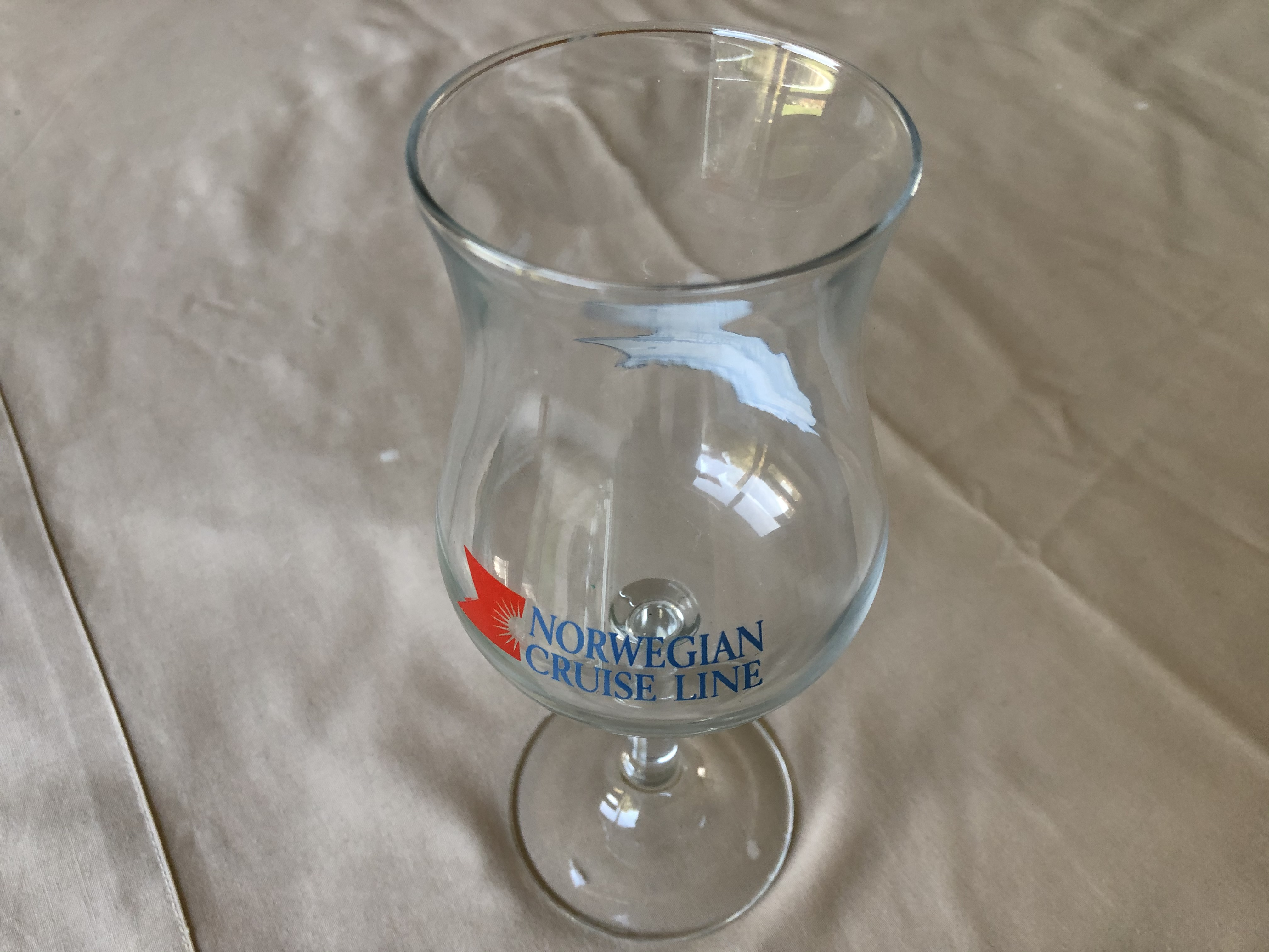 ONBOARD BAR GLASS FROM THE VESSEL 'SEAWARD' OF THE NORWEGIAN CRUISE