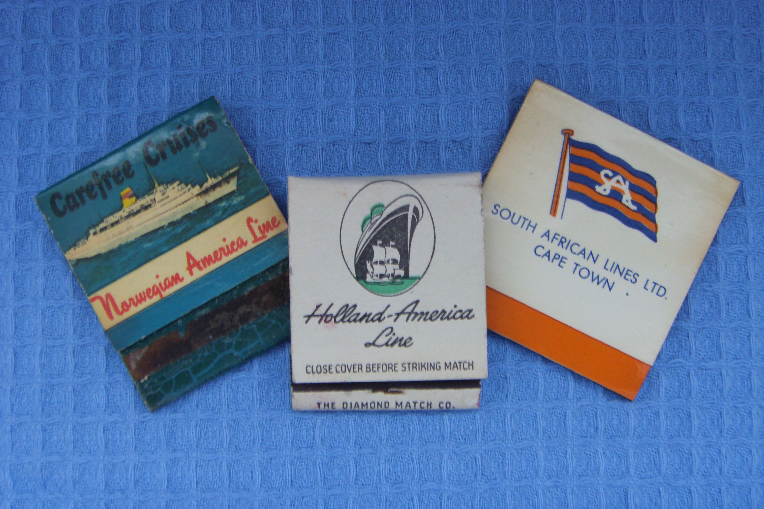 THREE VERY OLD BOOKS OF CIGARETTE MATCHES FROM VARIOUS OLD SHIPPING LINE COMPANIES