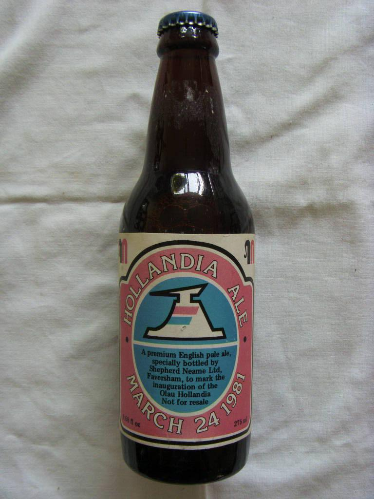 AN UNOPENED BOTTLE OF CELEBRATION BEER FOR THE VESSEL MS OLAU HOLLANDIA DATED MARCH 1981