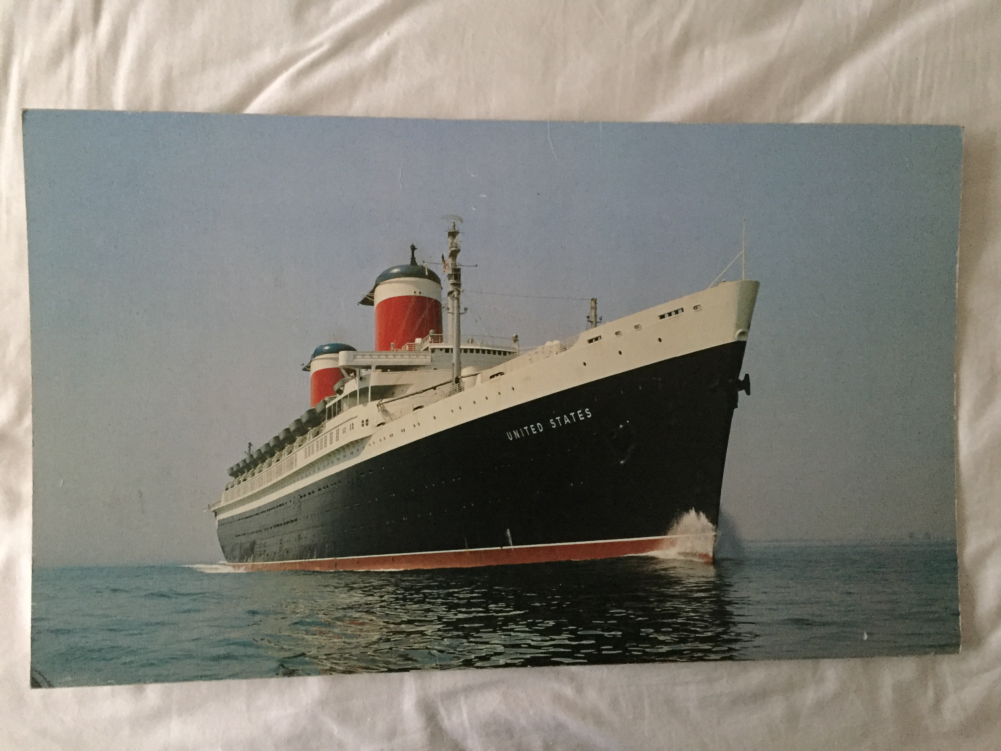LARGE PRINTED PICTURE OF THE VESSEL THE UNITED STATES WHICH IS ON CARDBOARD BACKING