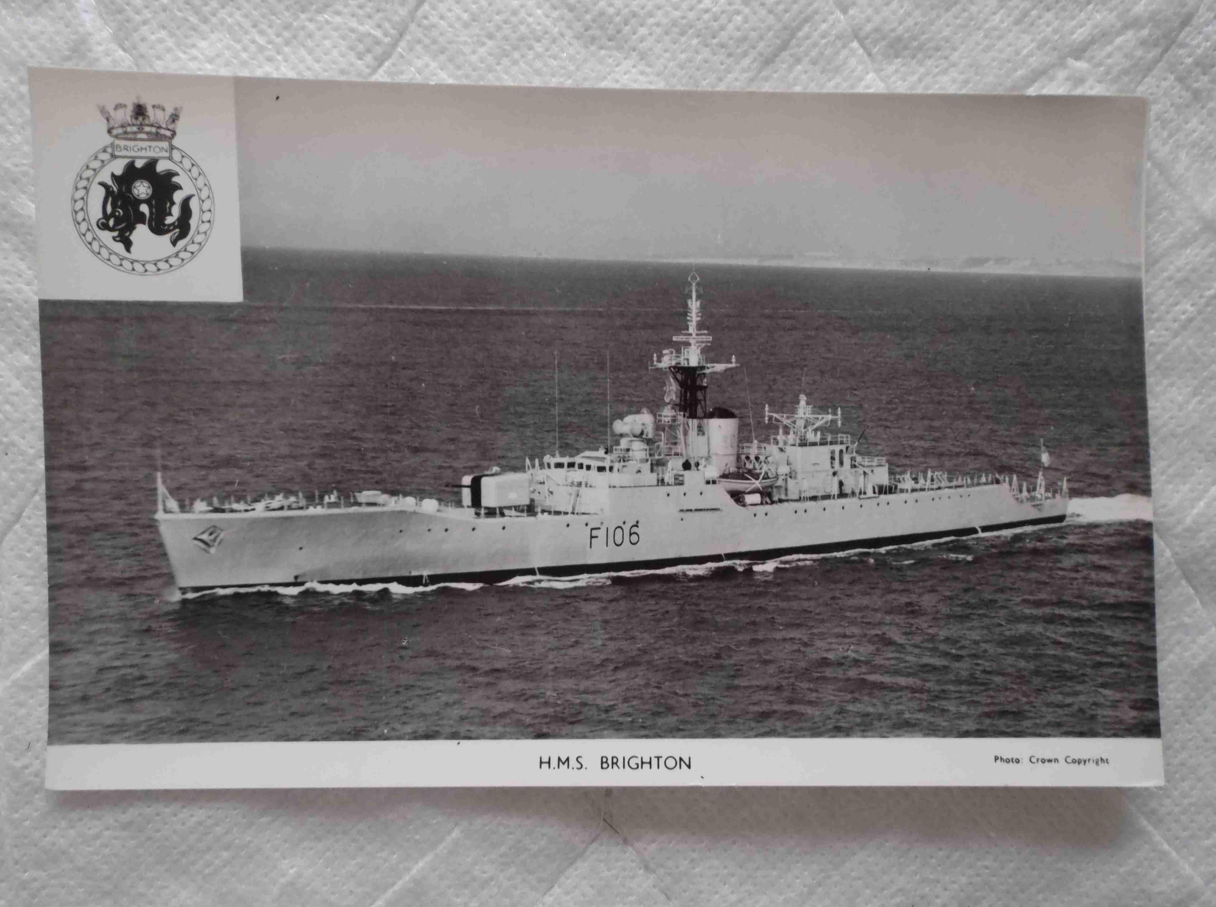 POSTCARD OF THE ROYAL NAVAL VESSEL HMS BRIGHTON
