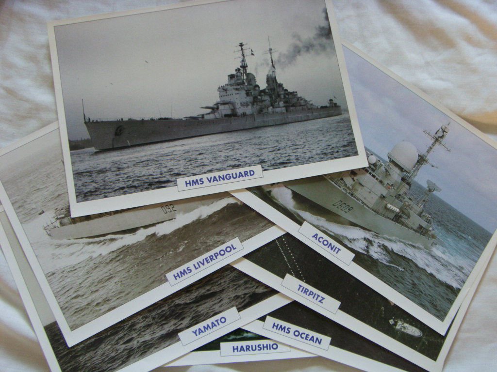 SET OF 7 FULL COLOUR PICTURES OF FAMOUS NAVAL VESSELS WITH FULL DETAILS ON THE REVERSE